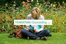 Woman in the park therapeutic journaling