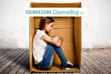 Girl confined sitting in small box